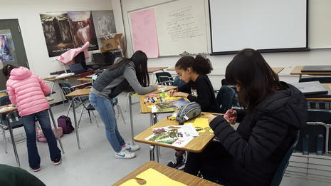 Students working on a collaborative art project